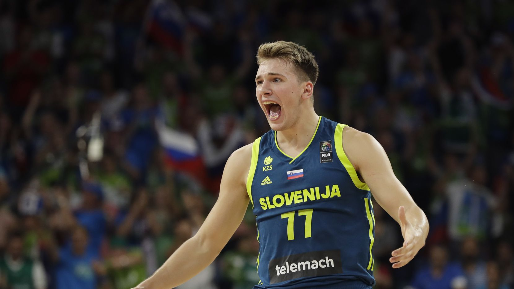 Slovenia's Luka Doncic reacts during their Eurobasket European Basketball Championship semifinal match against Spain in Istanbul, Thursday, Sept. 14. 2017.