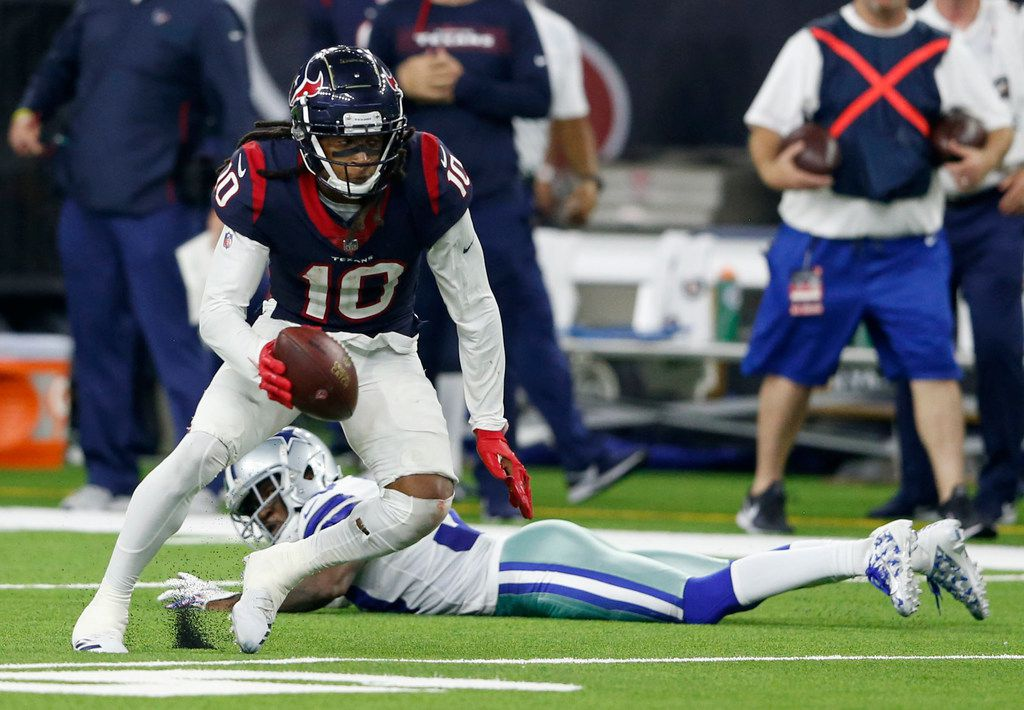 Houston Texans wide receiver DeAndre Hopkins (10) passes by Dallas Cowboys cornerback Anthony Brown (30) during overtime at NRG Stadium in Houston on Sunday, October 7, 2018. Houston Texans defeated Dallas Cowboys 19-16 in overtime. (Vernon Bryant/The Dallas Morning News)