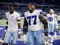 Dallas Cowboys offensive tackle Tyron Smith (77) is all smiles after their win over the Philadelphia Eagles at AT&T Stadium in Arlington, Monday, September 27, 2021. The Cowboys won, 41-21.