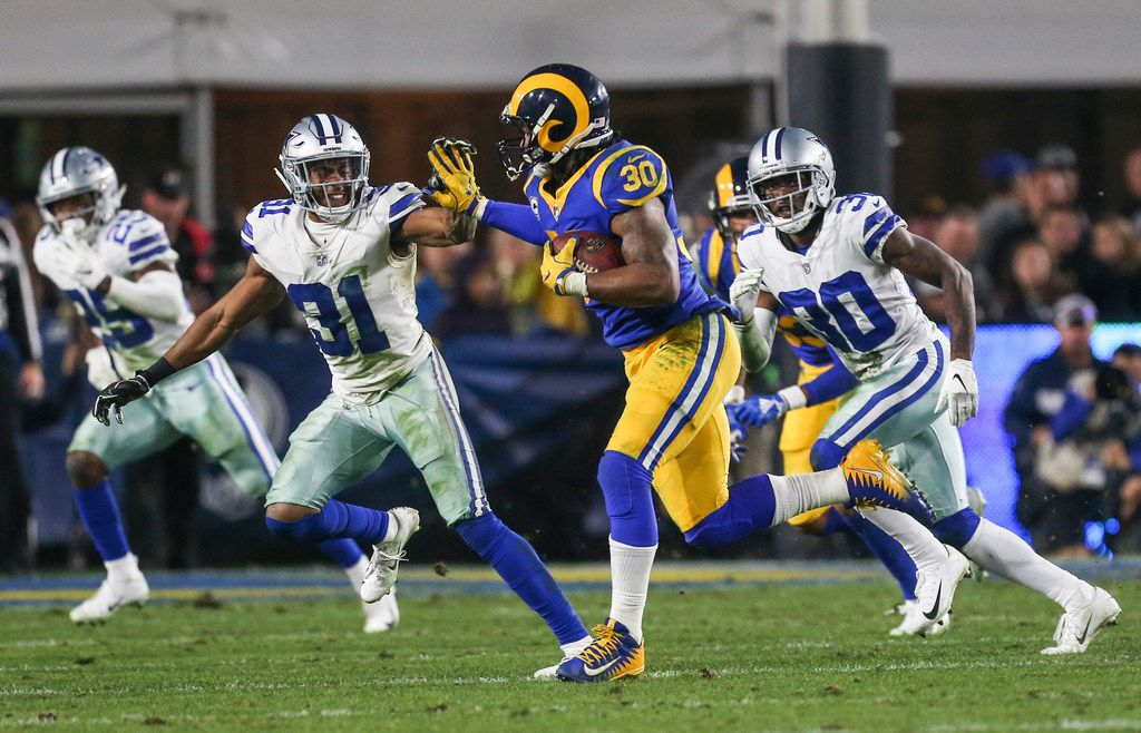 Los Angeles Rams running back Todd Gurley (30) attempts to make a break past Dallas Cowboys cornerback Byron Jones (31) during the fourth quarter of the Cowboys' 30-22 loss to the Los Angeles Rams in a NFC divisional playoff game Saturday, Jan. 12, 2019 at Los Angeles Memorial Coliseum in Los Angeles. (Ryan Michalesko/The Dallas Morning News)