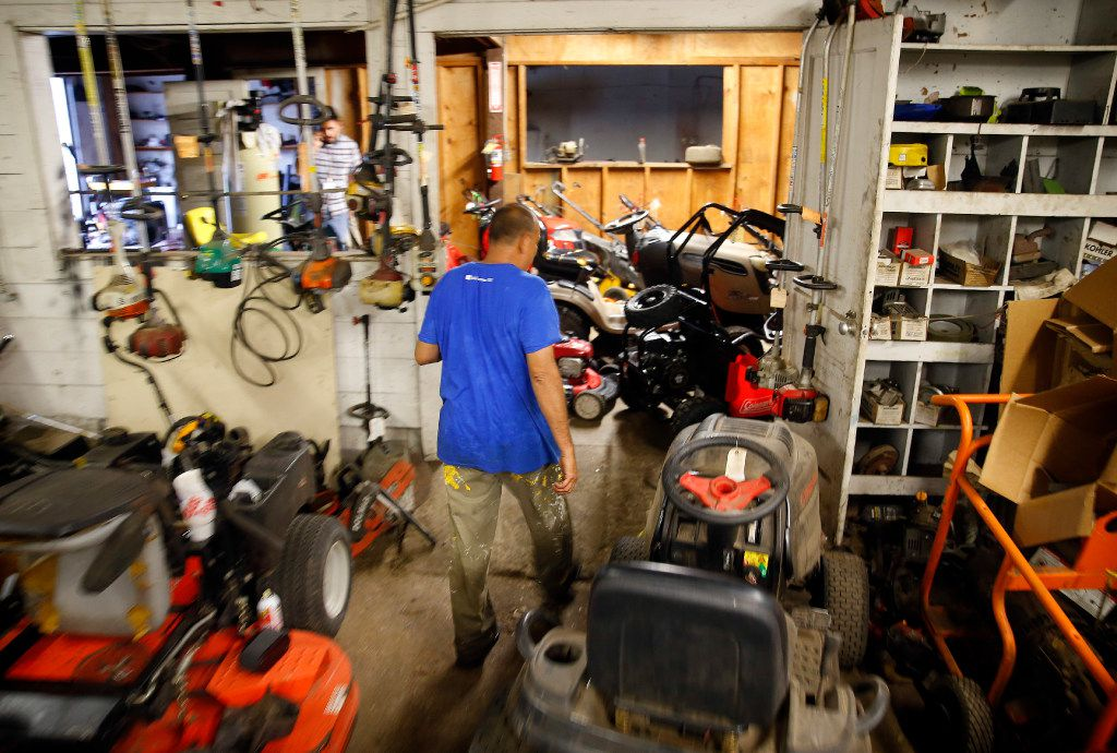 Small engine repairman Ruben Rosas walks among the many projects he has yet to finish at Daniel's Small Engine Repair in Victoria on Friday, August 25, 2017. Rosas was fixing generators the day Hurricane Harvey made landfall.
