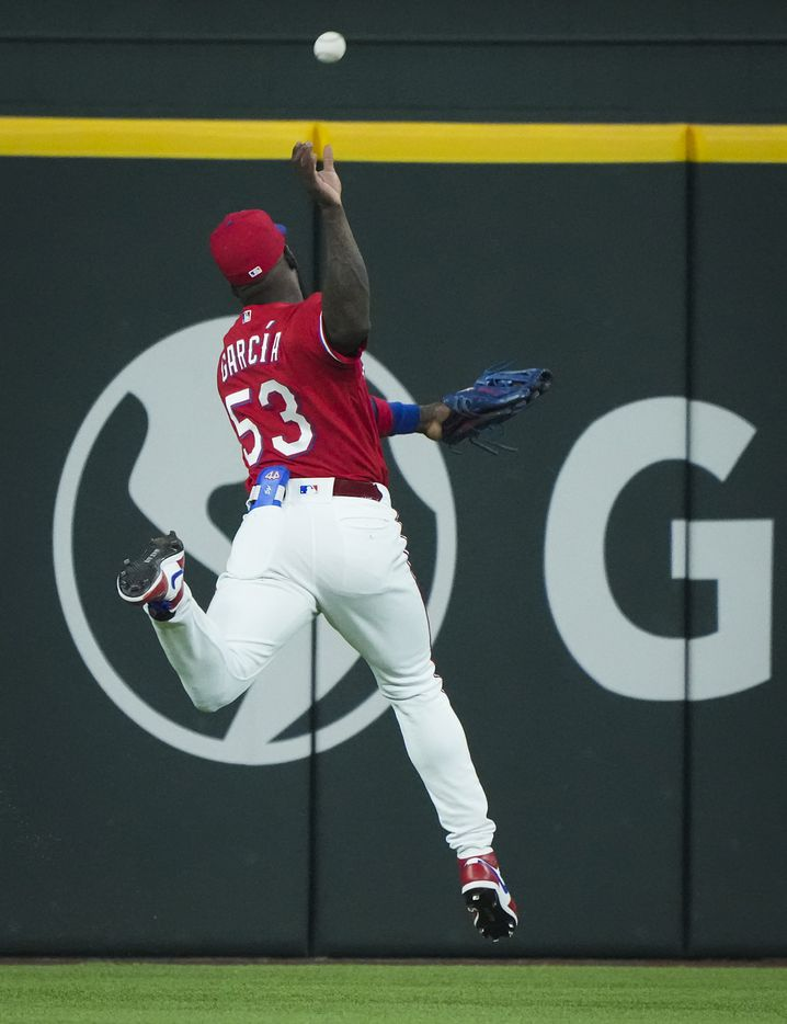 Texas Rangers center fielder Adolis Garcia can't make the play on a double off the bat of Minnesota Twins first baseman Alex Kirilloff during the fourth inning at Globe Life Field on Friday, June 18, 2021.