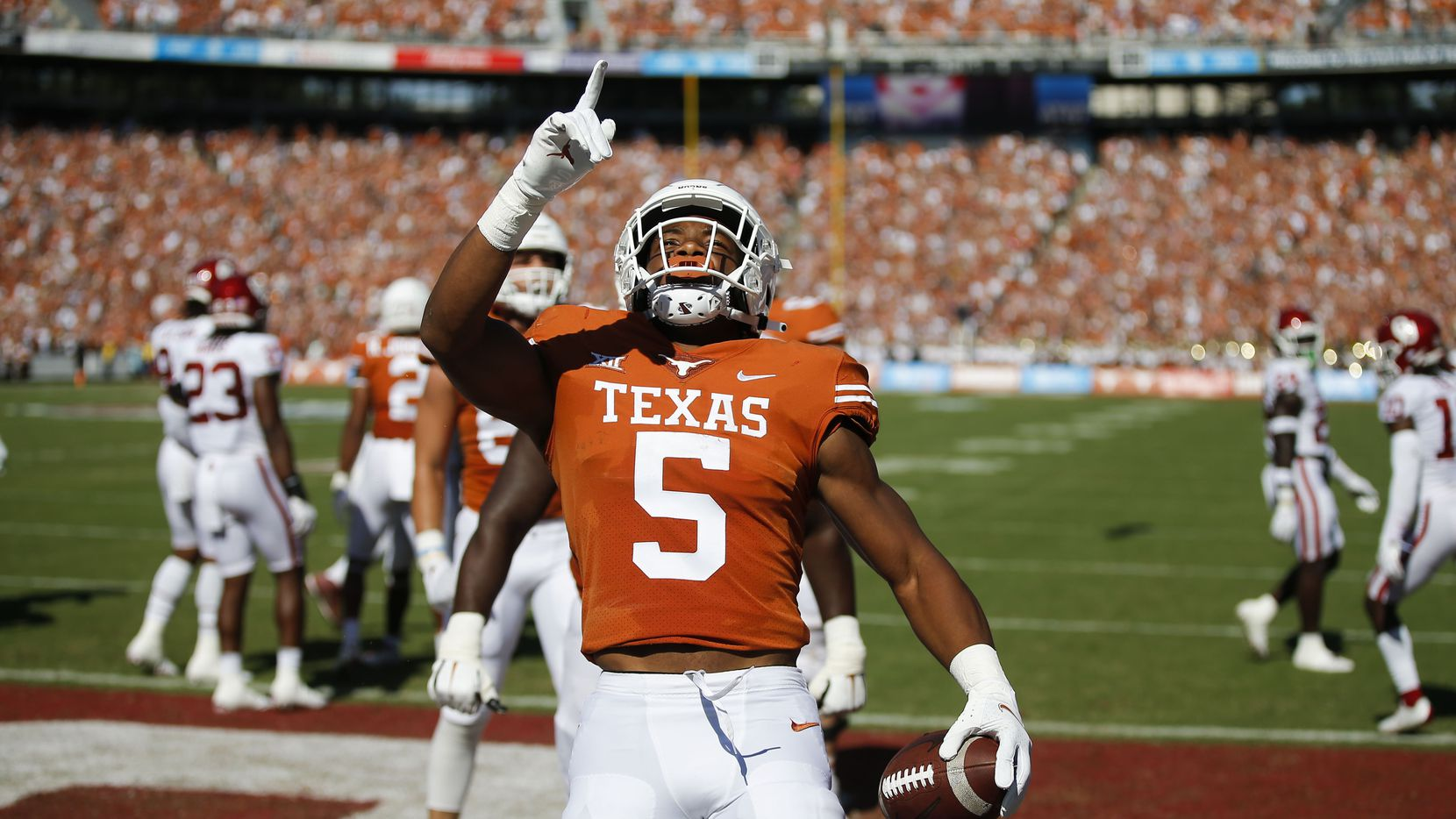 Texas running back Bijan Robinson (5) celebrates scoring a touchdown during the first half of an NCAA college football game against Oklahoma at the Cotton Bowl in Fair Park, Saturday, October 9, 2021. (Brandon Wade/Special Contributor)