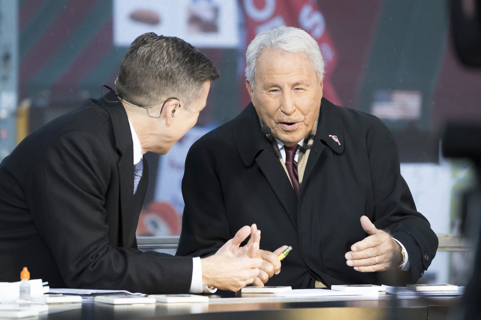 Lee Corso talks with Rece Davis during ESPN College GameDay on Beale Street before an NCAA football game  between Memphis and SMU on Saturday, Nov. 2, 2019, in Memphis, Tenn.