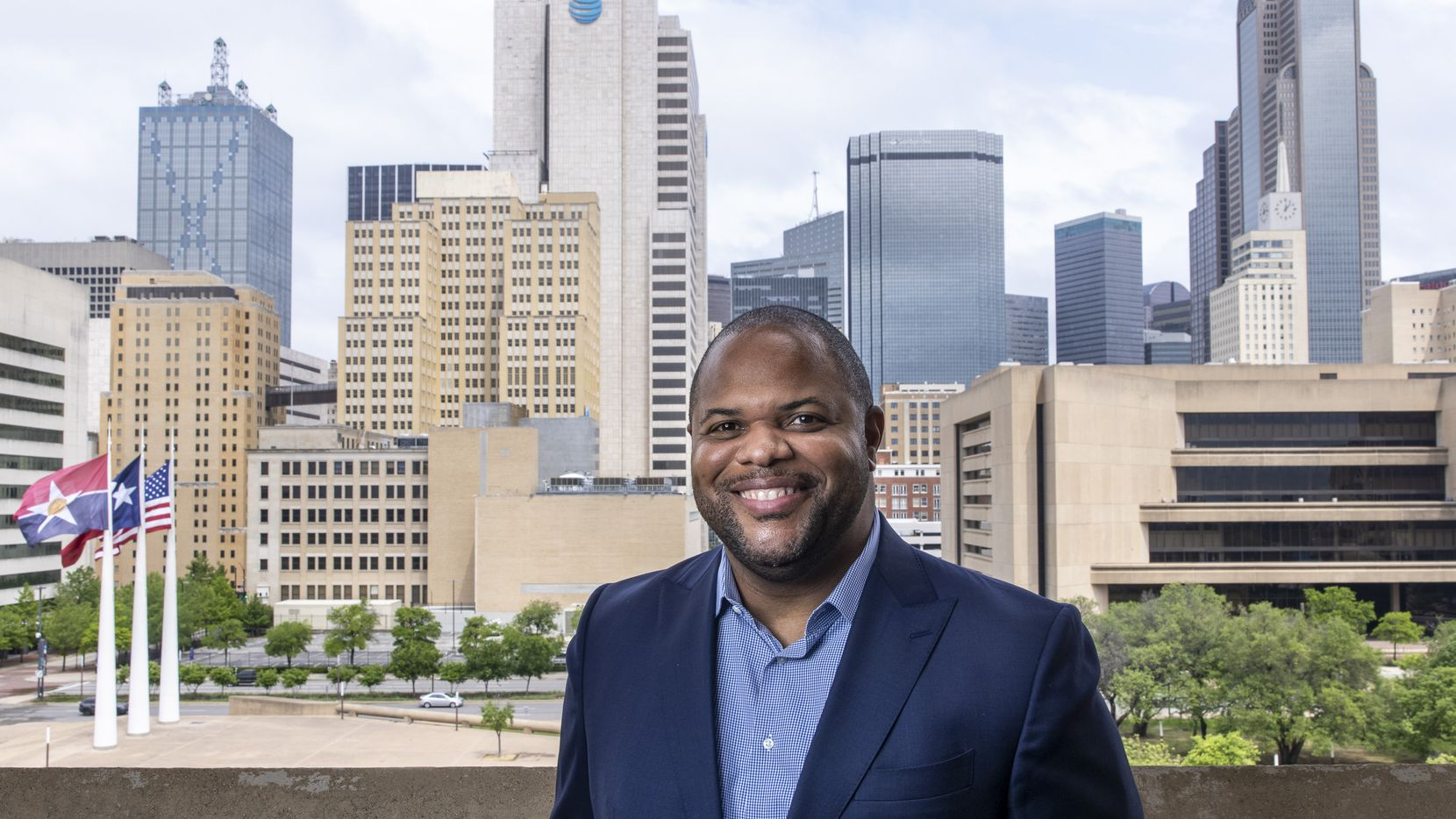 """Mayor Eric Johnson on the balcony outside his office at Dallas City Hall on Thursday after an interview with The Dallas Morning News. """"I am willing to do whatever it takes to advance this agenda on behalf of the city of Dallas,"""" Johnson told Metro columnist Sharon Grigsby."""