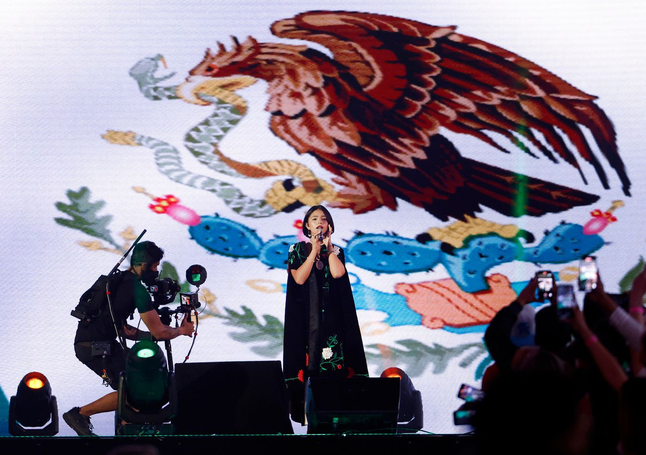 Angela Aguilar Alvarez, 17, performed the Mexican national anthem, Himno Nacional Mexicano, before the Canelo Alvarez/Billy Joe Saunders unified super middleweight title fight at AT&T Stadium in Arlington, Saturday, May 8, 2021. (Tom Fox/The Dallas Morning News)