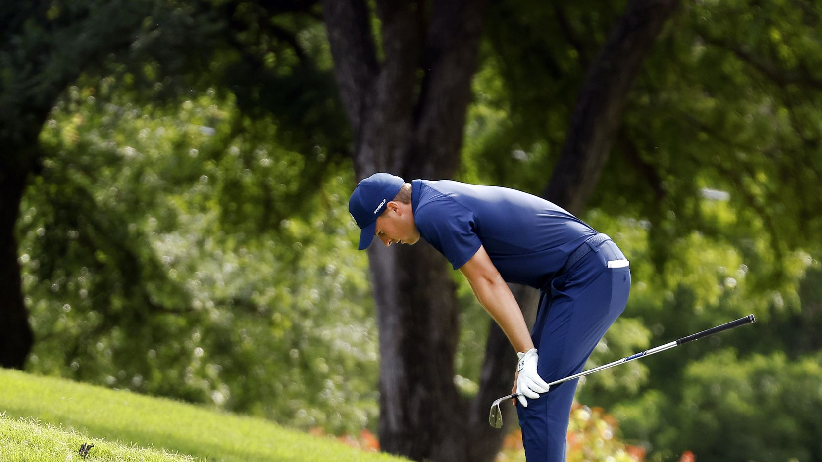 Professional golfer Jordan Spieth reacts after his approach shot fell short of the No. 15 green during the final round of the Charles Schwab Challenge at the Colonial Country Club in Fort Worth, Sunday, May 30, 2021. Spieth finished second, 2 shots behind Jason Kokrak.