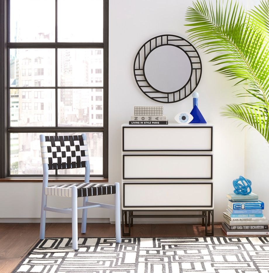 The black-and-white pieces in the the Now House collection feature clean lines and graphic accents. The three-drawer dresser by Jonathan Adler is $448.