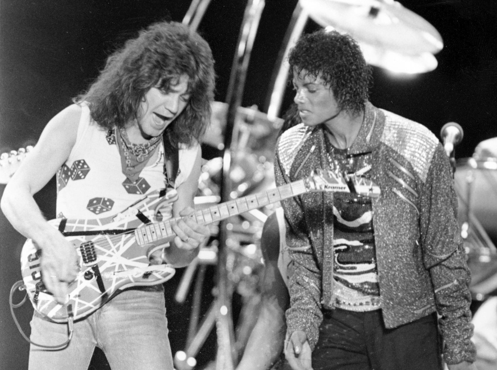 """Eddie Van Halen, left, and Michael Jackson perform """"Beat It"""" during Jackson's Victory Tour concert in Irving, Texas on July 14, 1984."""