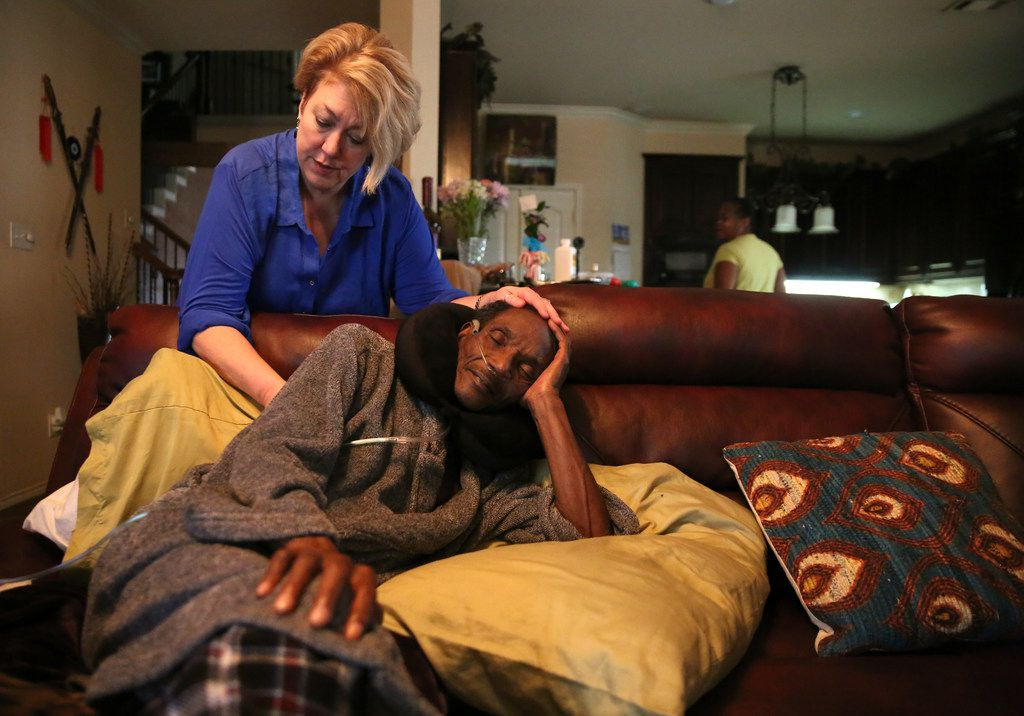 Michelle Moore, the attorney who helped exonerate Johnnie Lindsey gave him a back rub at his home in Dallas on Saturday.