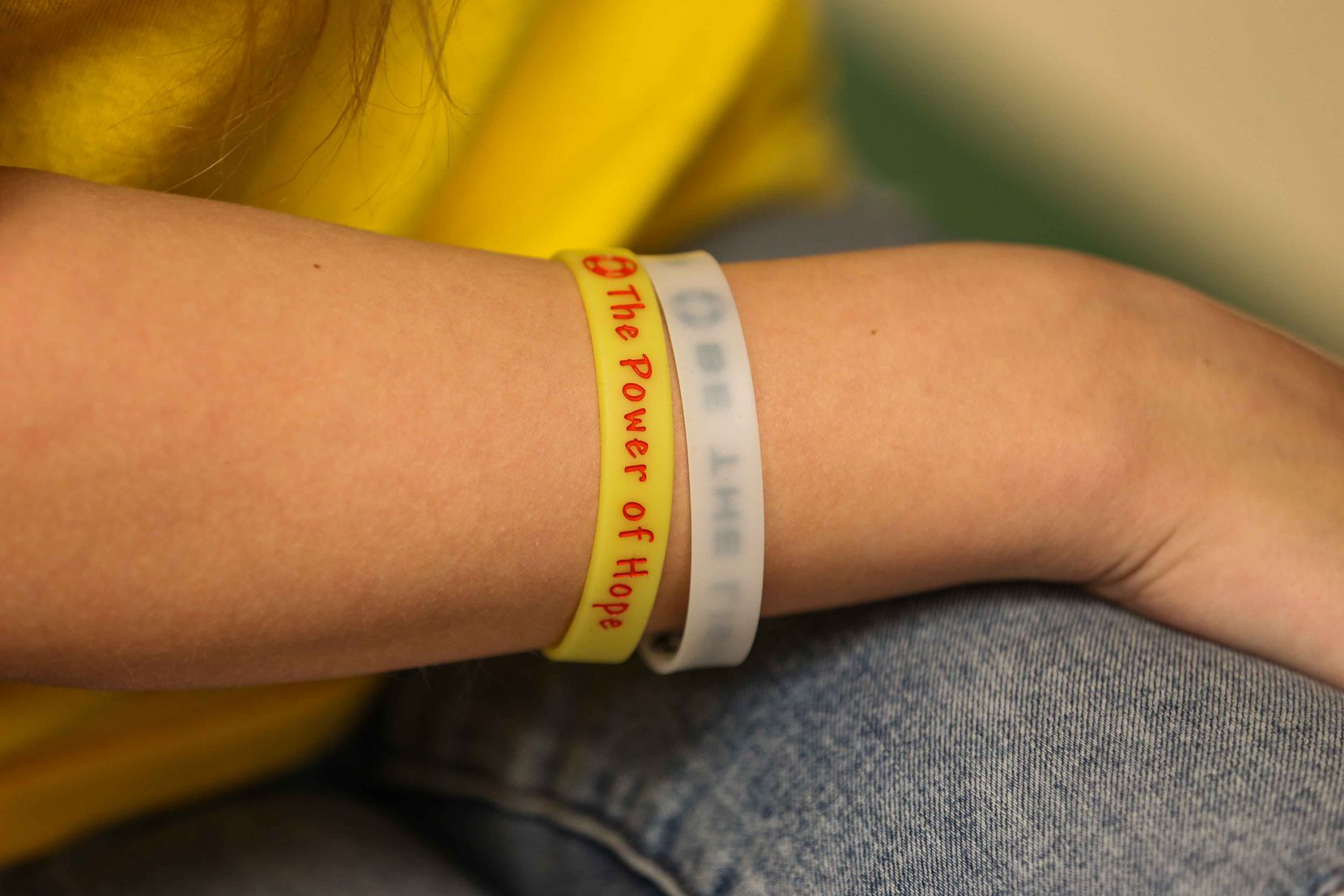"One of the 75 Hope Squad members at Prosper High School regularly wears a yellow band that reads ""The Power of Hope."""