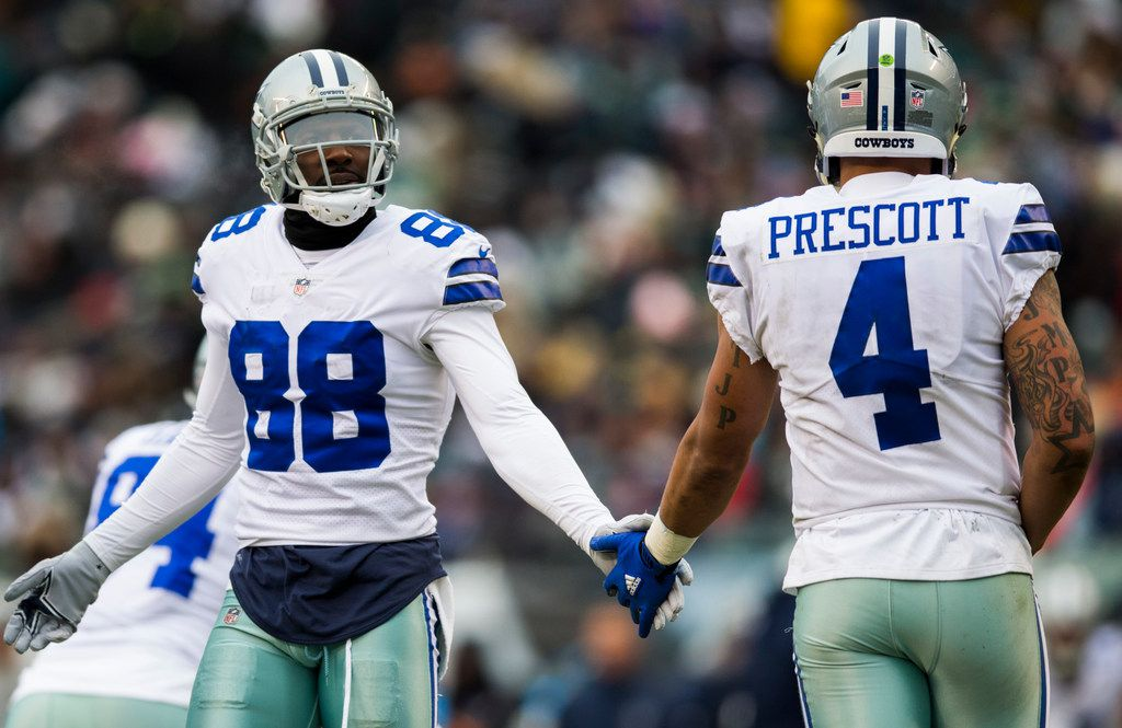FILE - Cowboys wide receiver Dez Bryant (88) high-fives quarterback Dak Prescott (4) during the second quarter of a game against the Eagles on Sunday, Dec. 31, 2017, at Lincoln Financial Field in Philadelphia.