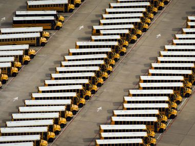 Aerial view of parked school buses at the Dallas ISD Student Transportation Services' North Dallas Lot on Wednesday, April 1, 2020, in Dallas, Texas.
