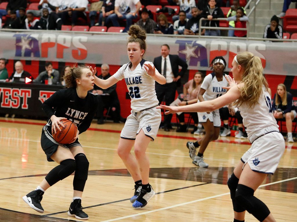 Bishop Lynch 's Paige Bradley (15) draws a double team against The Village School in last season's TAPPS 6A state championship game. (Jose Yau/Special Contributor)