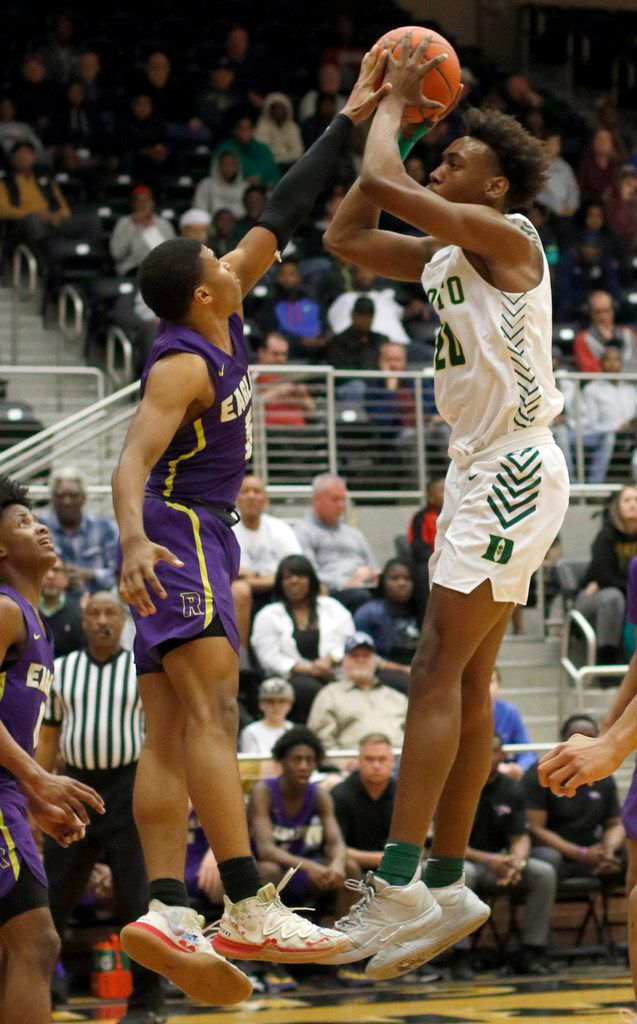 DeSoto's Christen Morgan (20) shoots a jump shot as he is defended by Richardson's Tre Howell (5) during first half action. Richardson won 63-51 to advance. The two teams played their Class 6A boys bi-district playoff basketball game at Forney High School in Forney on February 24 2020. (Steve Hamm/Special Contributor).