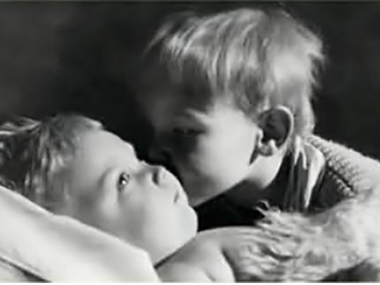 The author's brother Bruno kisses their brother Oliver, who was born with severe brain damage.