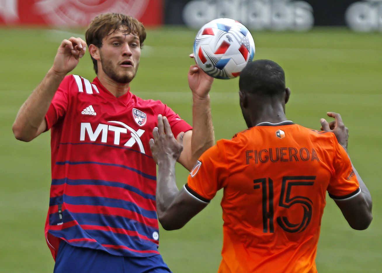 FC Dallas midfielder Tanner Tessmann (15) prepares to intercept a header by Houston Dynamo defender Maynor Figueroa (15) during the first half as FC Dallas hosted the Houston Dynamo at Toyota Stadium in Frisco on May 8, 2021. (Stewart F. House/Special Contributor)