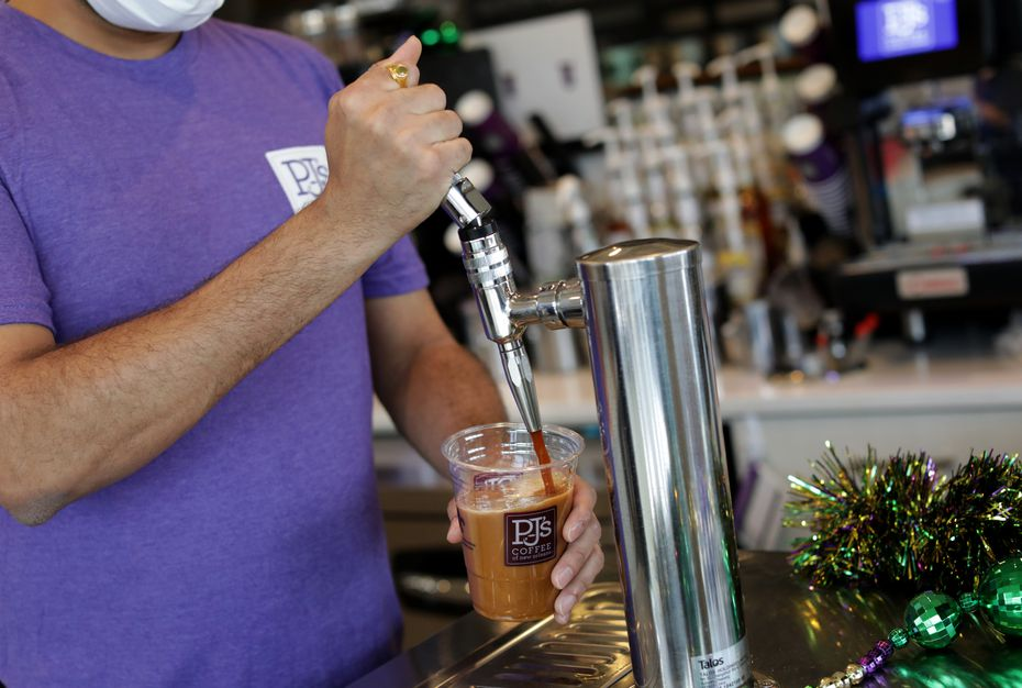 Ridham Bhatt pours a coffee at PJ's Coffee in McKinney in January 2021. The newest PJ's opened in Euless in August 2021.