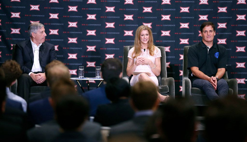 Moderator Bonnie Bernstein, center, talks next to Bob Bowlsby, Commissioner of Big 12 Conference, left, and Mark Cuban, owner of the Dallas Mavericks and the NBA franchiseÕs Mavs Gaming NBA 2K team, during a panel discussion on eSports at the Big 12 ConferenceÕs state of college athletics forum at Statler Hotel in Dallas, Wednesday, May 23, 2018. (Jae S. Lee/The Dallas Morning News)