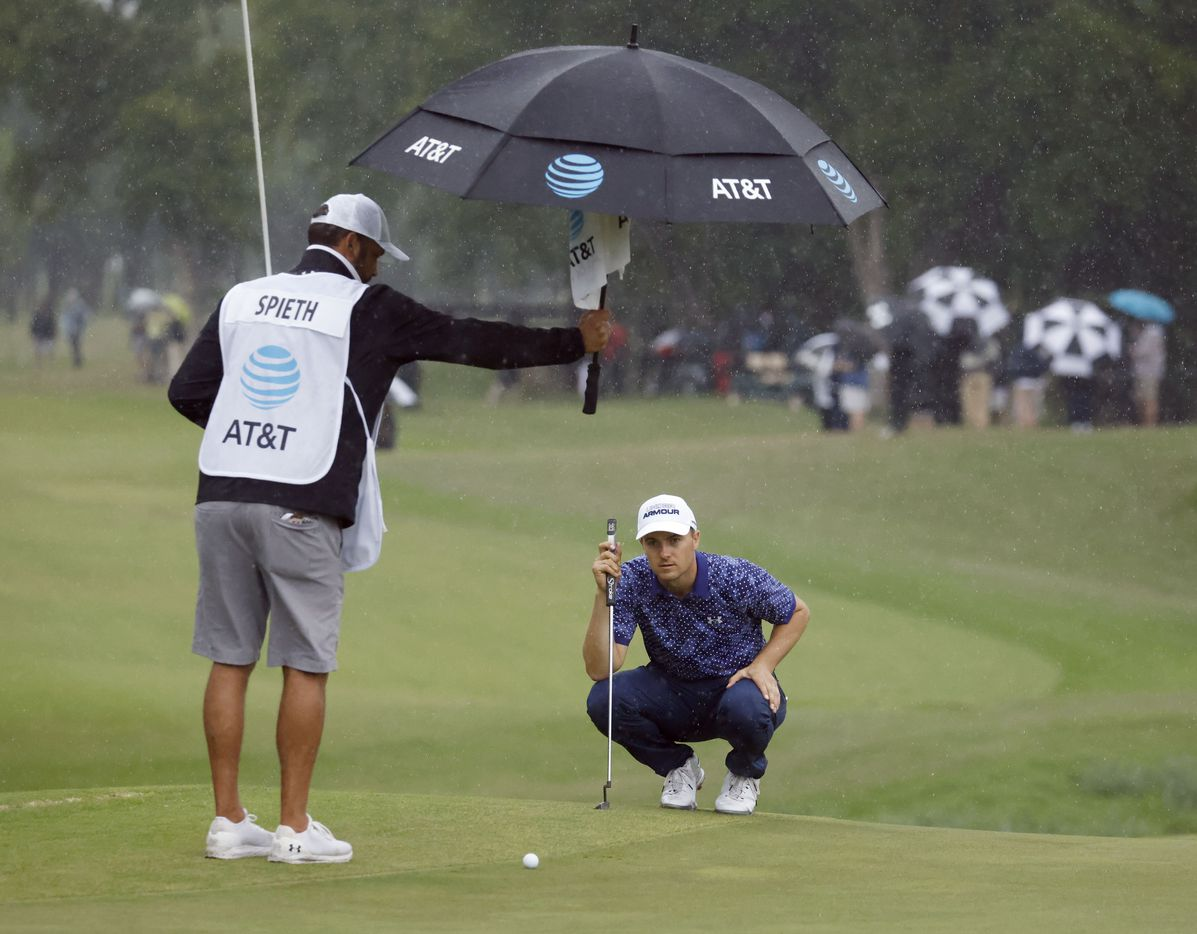 Jordan Spieth surveys the land before putting in the rain on the 9th hole during round 4 of the AT&T Byron Nelson  at TPC Craig Ranch on Saturday, May 16, 2021 in McKinney, Texas. (Vernon Bryant/The Dallas Morning News)