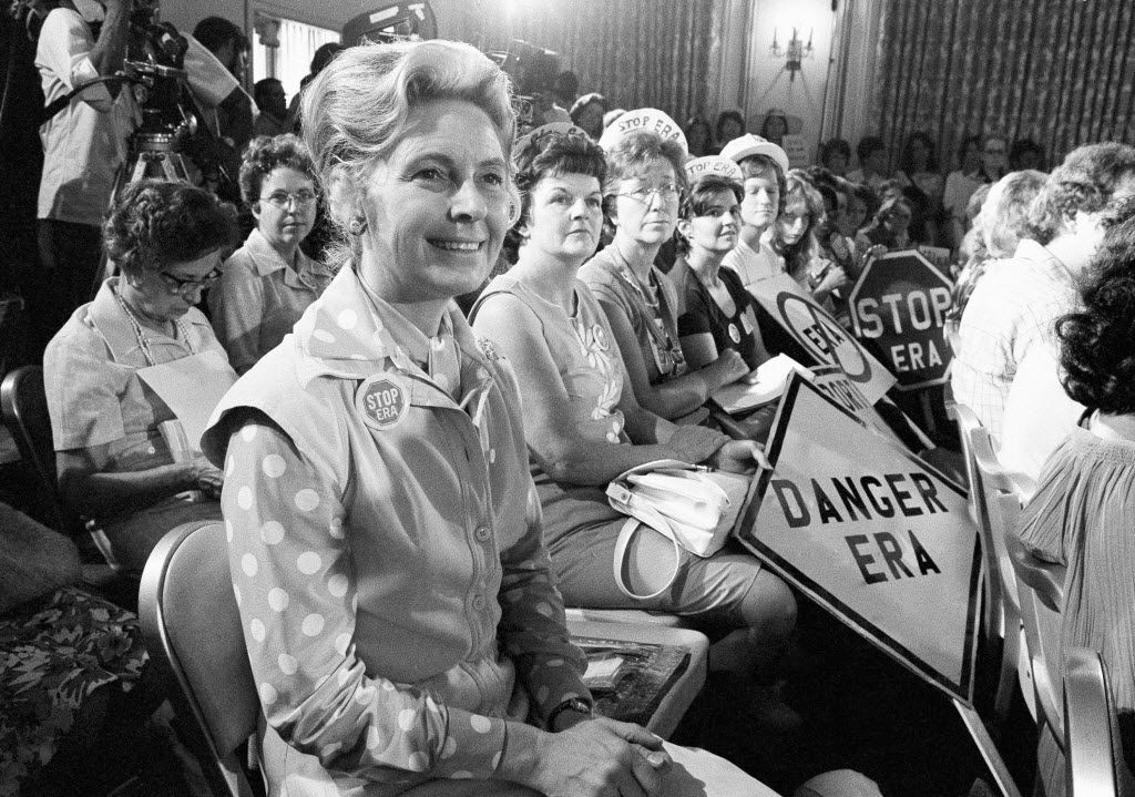 Women opposed to the Equal Rights Amendment sit with Phyllis Schlafly (left) national chairman of Stop ERA, at hearing of Republican platform subcommittee on human rights and responsibilities in a free society in 1976 in Kansas City, Mo. Schlafly was credited with helping mobilize public opinion against the amendment in some of the states that balked at ratifying it in the early years of its existence.