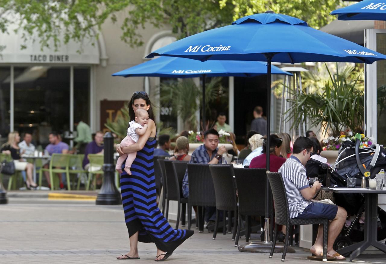 The West Village area of Uptown has helped spur the broader revitalization of McKinney Avenue, as the crowd at Mi Concina shows. But the gentrification of the area has its critics, too.