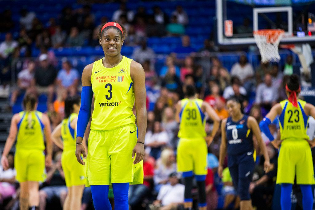 Dallas Wings guard Kaela Davis (3) smiles during a time out during the fourth quarter of a WNBA game between the Dallas Wings and the Indiana Fever on Thursday, July 5, 2018 at UTA's College Park Center in Arlington, Texas. (Ashley Landis/The Dallas Morning News)