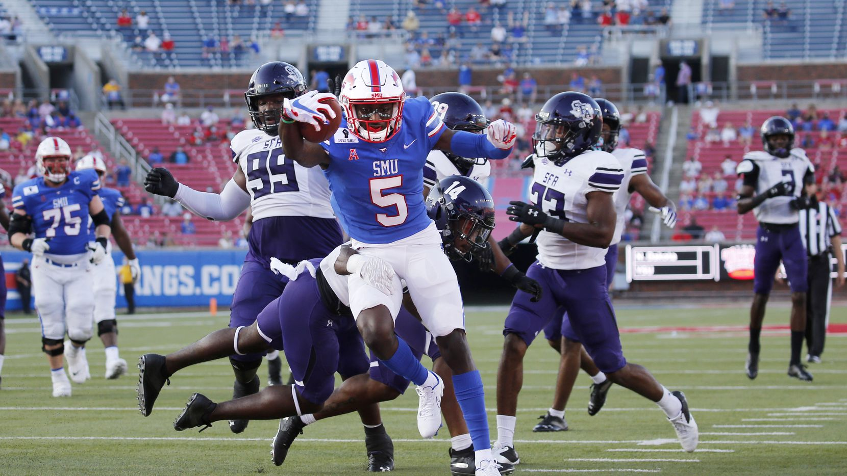 Southern Methodist Mustangs wide receiver Danny Gray (5) scores a touchdown as Stephen F. Austin Lumberjacks defensive back Kris McCune (14) fails to stop him during the first half of their home opener at Ford Stadium in Dallas, on Saturday, September 26, 2020.