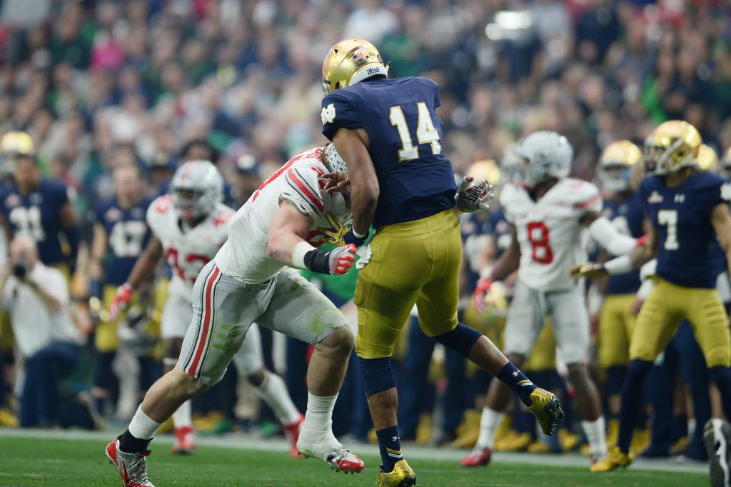 Jan 1, 2016; Glendale, AZ, USA; Ohio State Buckeyes defensive lineman Joey Bosa (97) hits Notre Dame Fighting Irish quarterback DeShone Kizer (14) during the first half of the 2016 Fiesta Bowl at University of Phoenix Stadium. Bosa would be penalized for targeting and ejected from the game. Mandatory Credit: Joe Camporeale-USA TODAY Sports