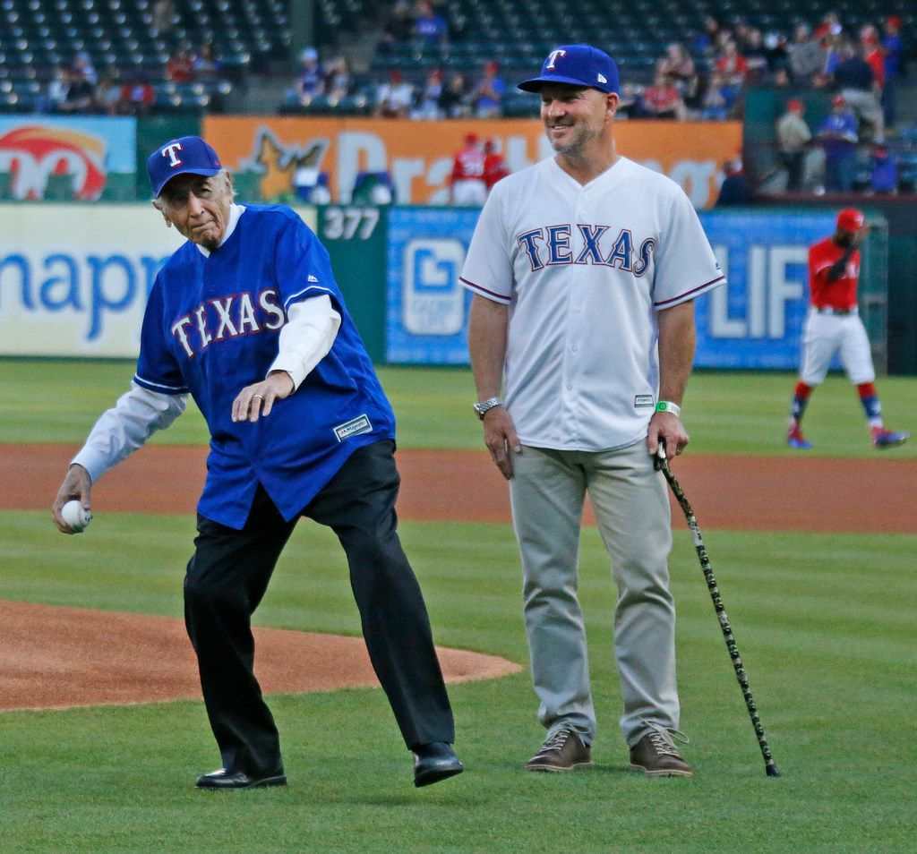 Mike Karns (right) bought the El Fenix restaurants from the Martinez family in 2008. Here, in April 2018,  Alfred Martinez, then 93, threw out the ceremonial first pitch at a Texas Rangers game with current owner Karns by his side.