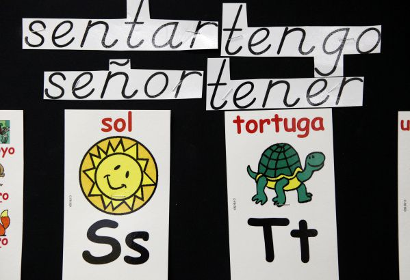 Signs written in Spanish are posted in a second-grade bilingual class at Farmers Branch Elementary School, which serves a predominantly Latino, low-income population in Farmers Branch.