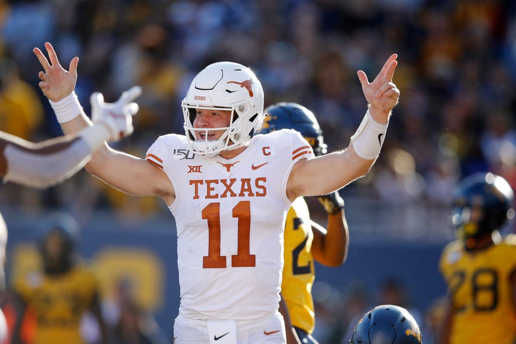 MORGANTOWN, WV - OCTOBER 05: Sam Ehlinger #11 of the Texas Longhorns celebrates after a 13-yard touchdown run in the second quarter against the West Virginia Mountaineers at Mountaineer Field on October 5, 2019 in Morgantown, West Virginia. (Photo by Joe Robbins/Getty Images)