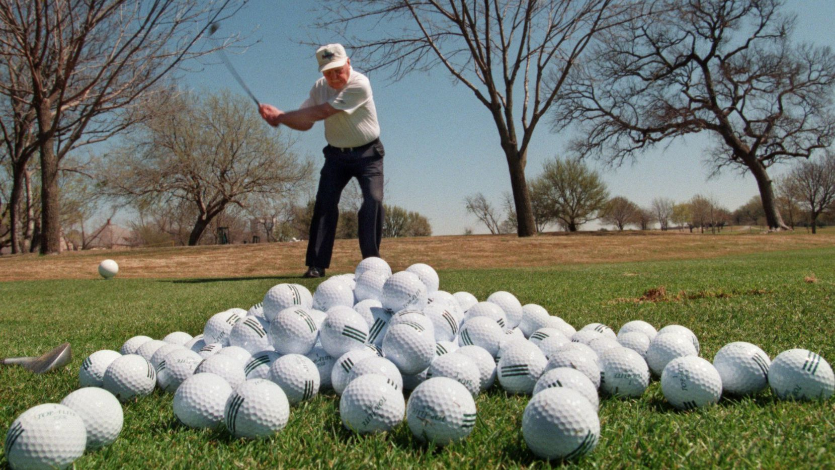A member works on his game on the driving range at Preston Trail Country Club in Dallas. Membership in the invitation-only private club remains open only to men.