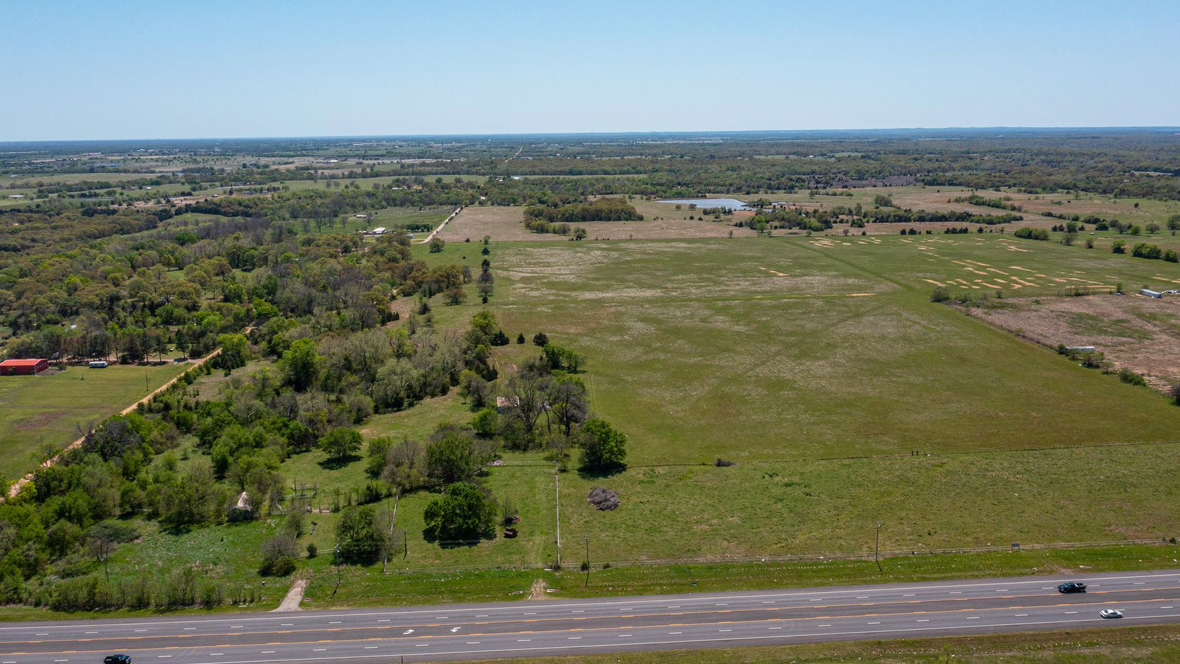 Offered at $6.9 million, this property in Mead, Oklahoma features a 9-acre lake, ponds, barns, silos and wells.