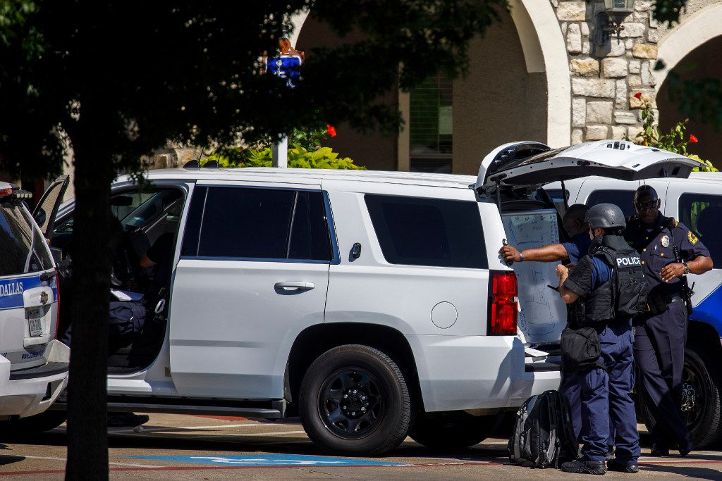 Dallas Police Department SWAT officers work the scene where someone shot at officers attempting to make an arrest at an east Oak Cliff apartment complex, police said, on Thursday, July 13, 2017, in Dallas.