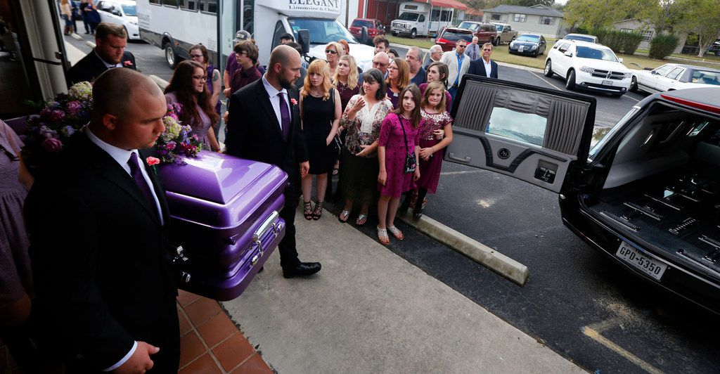 Friends and family watch as pall bearers transport Annabelle Pomeroy's casket during funeral service at First Baptist Church of La Vernia in La Vernia, Texas on Nov. 13, 2017. Annabelle was killed in the First Baptist Church in Sutherland Springs, Texas the site of a shooting that killed 26 parishioners and left 30 injured. (Nathan Hunsinger/The Dallas Morning News)
