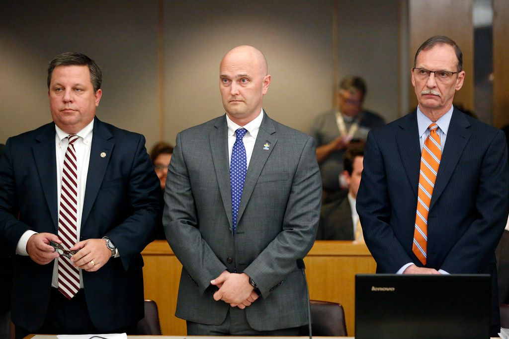 Roy Oliver was flanked by his attorneys Miles Brissette (left) and Bob Gill before the guilty verdict Tuesday in his murder trial at the Frank Crowley Courts Building in Dallas.