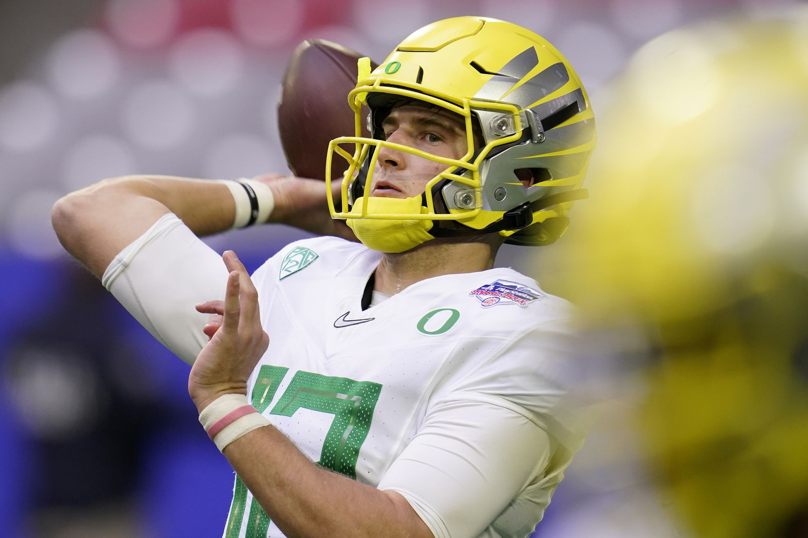 Oregon quarterback Tyler Shough (12) warms up prior to the Fiesta Bowl NCAA college football game against Iowa State, Saturday, Jan. 2, 2021, in Glendale, Ariz.