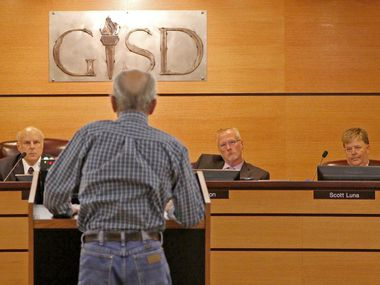 Arthur Shook, a 1966 graduate of South Garland High School, voiced his objections Tuesday to the removal of Confederate symbols at the school as he spoke to (from left) board member Linda Griffin, president Larry Glick, Superintendent Bob Morrison and vice president Scott Luna.