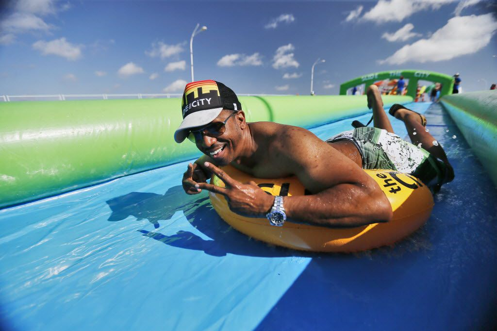 Marquess Jones slid down a water slide during the Slide the City event in the 3400 block of Sylvan Avenue in Dallas in June 2016.