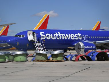 Southwest Airlines Boeing 737 MAX aircraft are parked on the tarmac after being grounded at an airport in Victorville, California.