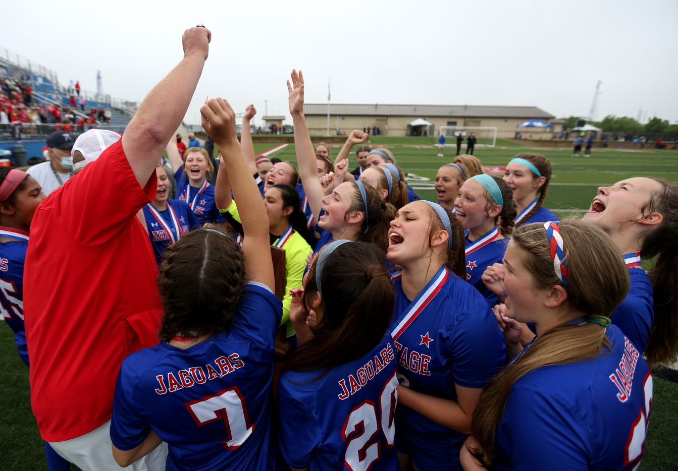 Midlothian Heritage head coach Gerald Slovacek cheers with his players at their win over Calallen at their UIL 4A girls State championship soccer game at Birkelbach Field on April 16, 2021 in Georgetown, Texas.