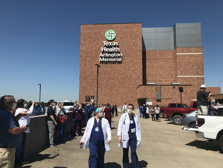 Hospital employees gather on the roof of the parking garage at Texas Health Arlington Memorial Hospital to watch the Blue Angels.