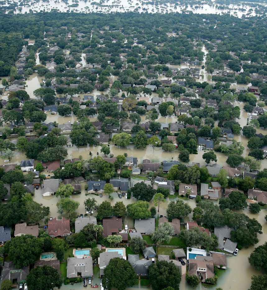 The flooded Bear Creek Village neighborhood, which borders the northwest side of the Addicks Reservoir in West Houston,was inundated by water that rose within the reservoir and spread into surrounding homes during Hurricane Harvey.