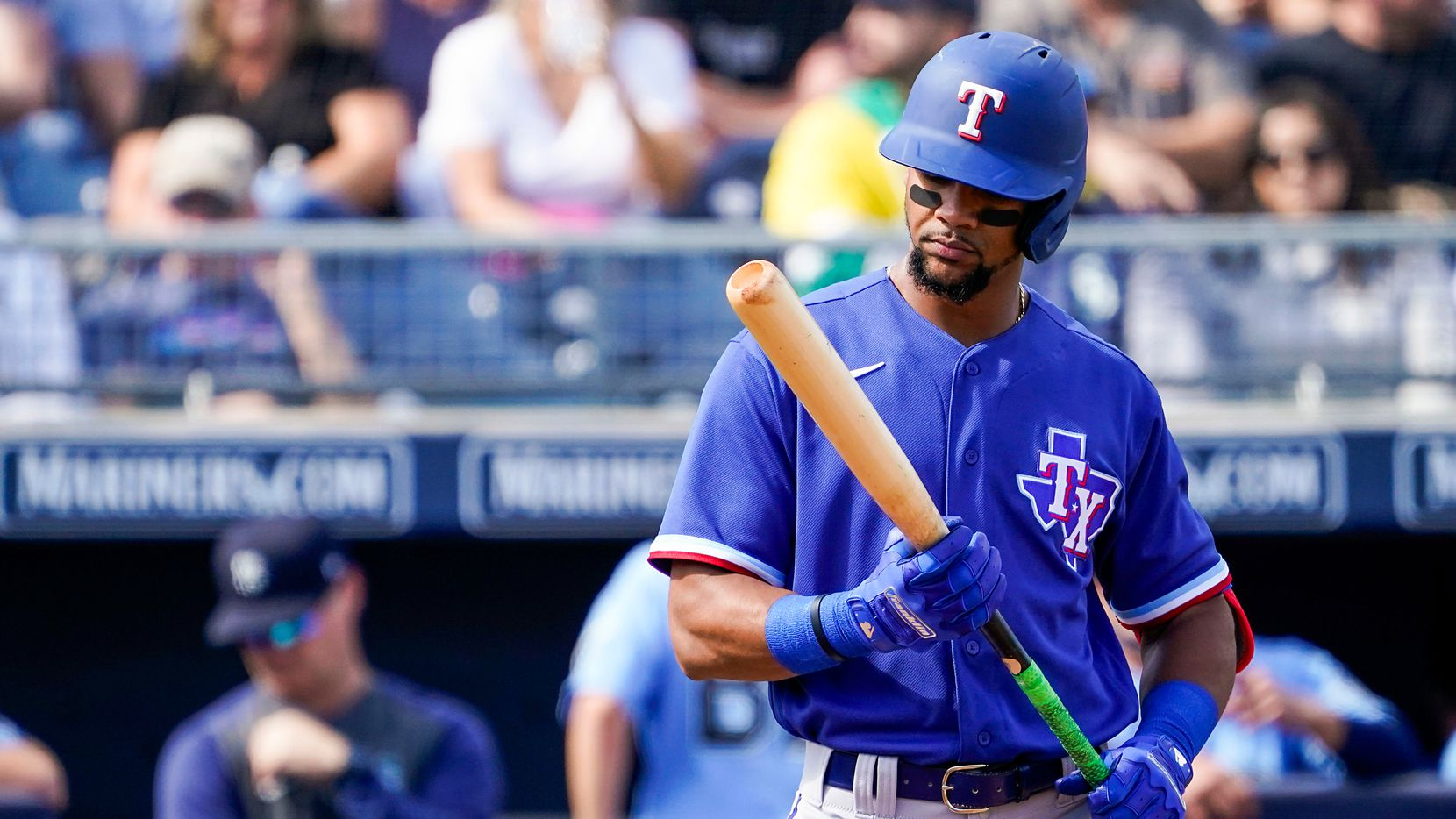 FILE — Texas Rangers outfielder Leody Taveras hits during the second inning of a spring training game against the Seattle Mariners at Peoria Sports Complex on Sunday, Feb. 23, 2020, in Peoria, Ariz.