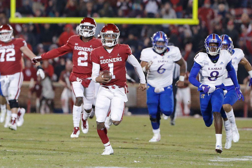 Oklahoma quarterback Kyler Murray (1) runs for a touchdown ahead of Kansas defenders during the second half of an NCAA college football game in Norman, Okla., Saturday, Nov. 17, 2018. Oklahoma won 55-40. (AP Photo/Alonzo Adams)