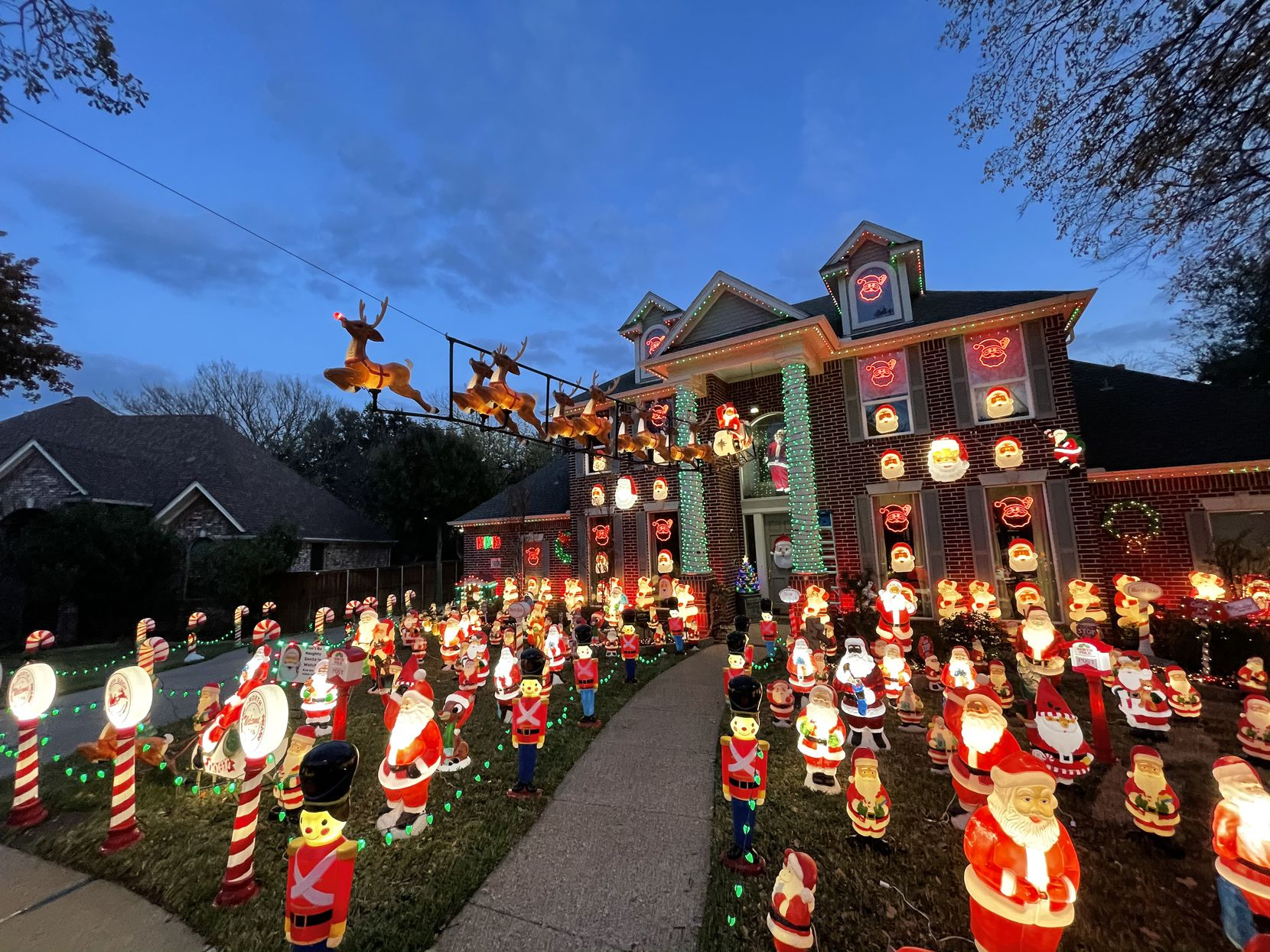 The Grapevine Santa House, which belongs to Louie Murillo, is covered in hundreds of Christmas decorations. The homeowners decided to use their Christmas display to encourage people to donate to local nonprofit GRACE.