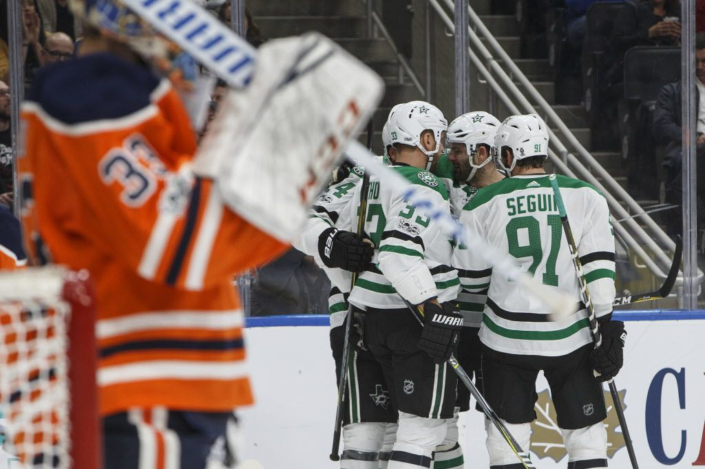 Dallas Stars players celebrate a goal against the Edmonton Oilers during the first period of an NHL hockey game, Thursday, Oct. 26, 2017 in Edmonton, Alberta. (Jason Franson/The Canadian Press via AP)