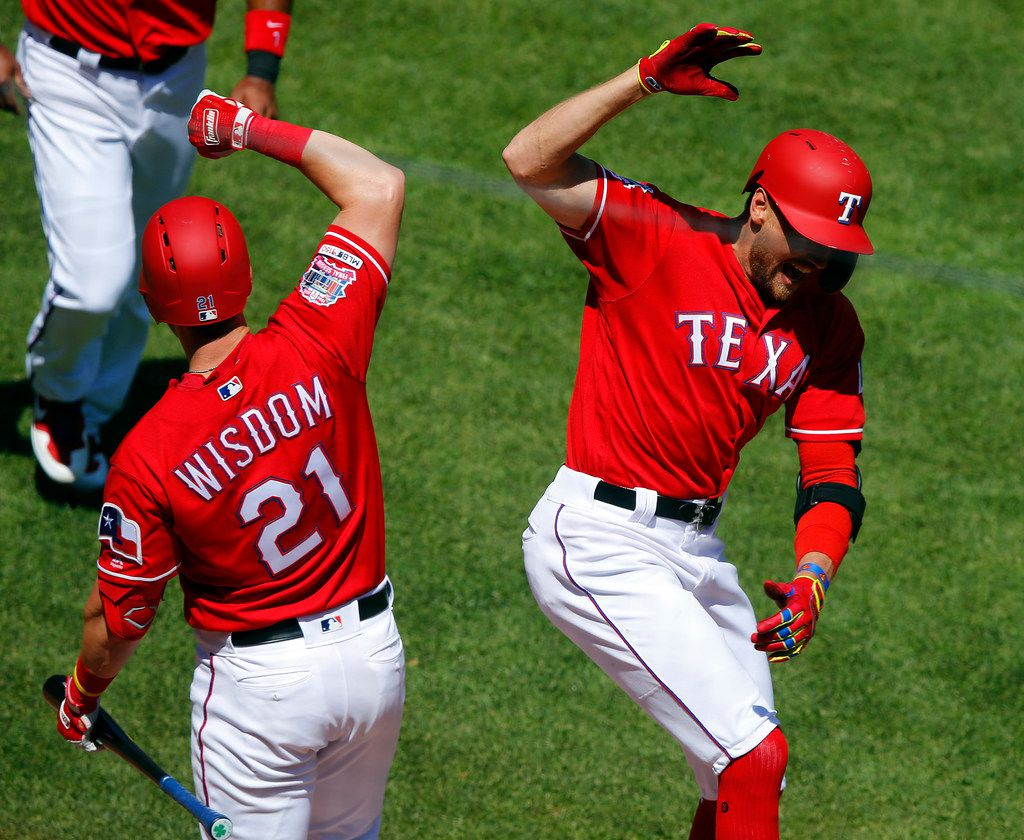 Texas Rangers right fielder Hunter Pence (right) is congratulated by teammate Patrick Wisdom (21) after hitting a two-run homer against the Houston Astros in the third inning at Globe Life Park in Arlington, Texas, April 21, 2019. (Tom Fox/The Dallas Morning News)