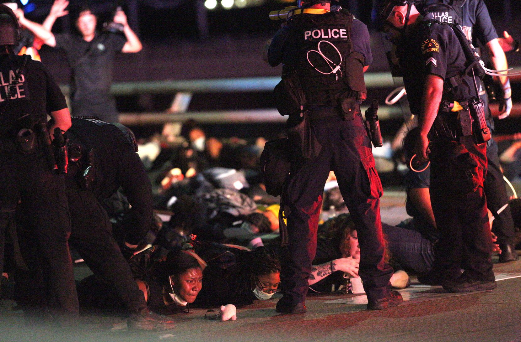 Police forced protesters to lie on the ground on the Margaret Hunt Hill Bridge while making arrests during the June 1 demonstration against police brutality.